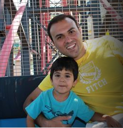 Saeed Abedini with one of his children.  From http://beheardproject.com/saeed#sign