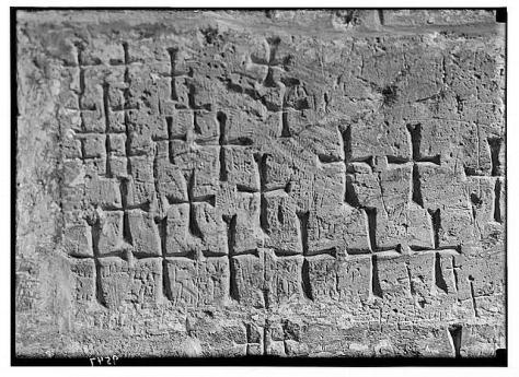 Crosses carved by pilgrims into a wall of the Holy Sepulchre, Jerusalem.  (Yair Talmor, Wikimedia Commons).