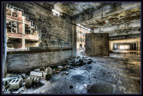 Abandoned building in Detroit that looks very much like a scene from the Fallout video game series. This it taken by an artist who has prints for sale, at http://bit.ly/1qeH2E1.